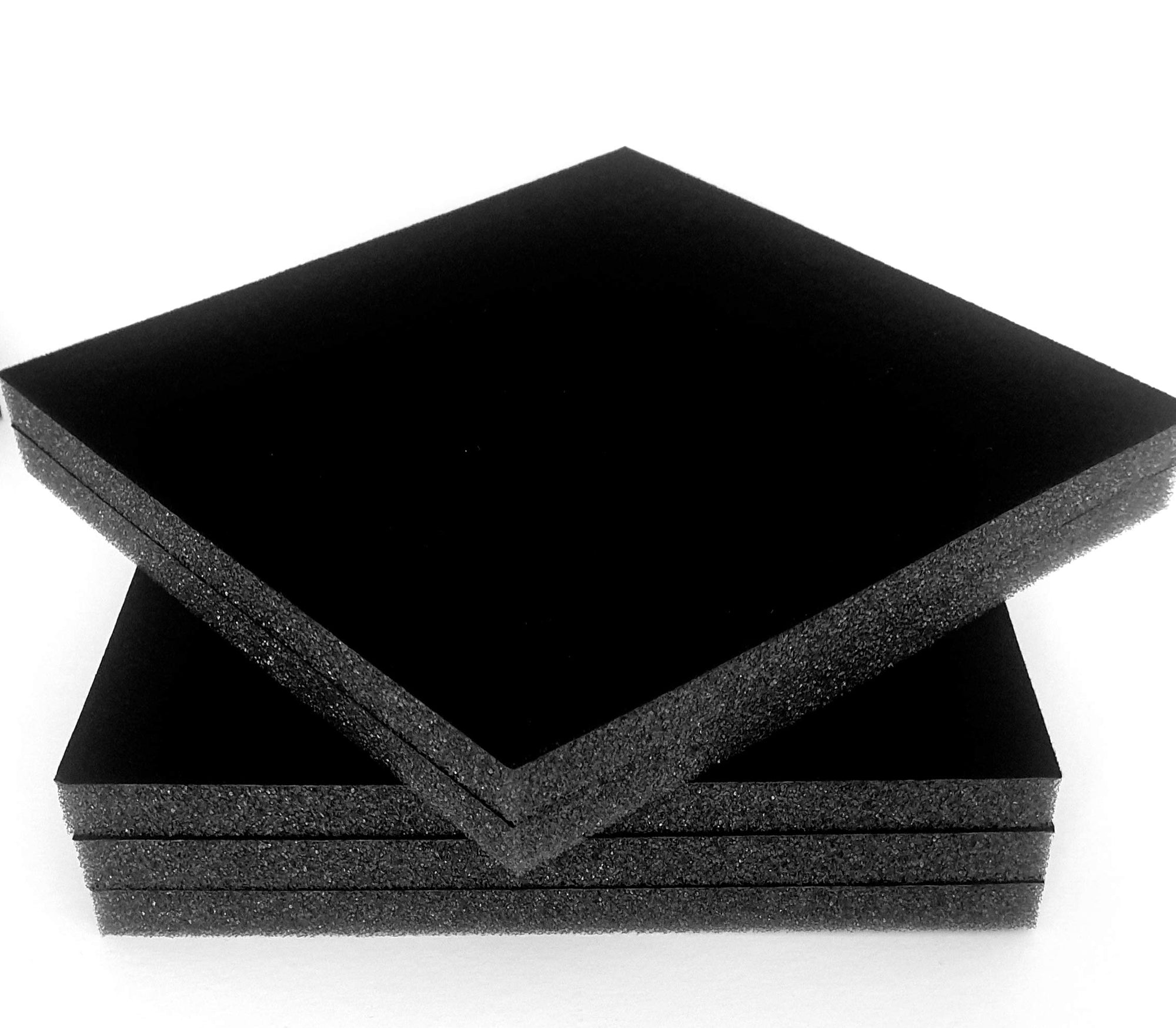 A stack of large sheets of velour flocked foam.