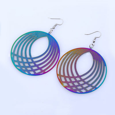 The Dazzle Collection - Hypnotika - Huge round UV treated stainless steel earrings that glow in a rainbow of colours.