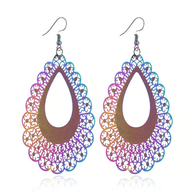 The Dazzle Collection - Escalace - UV treated stainless steel earrings that glow in a rainbow of colours.