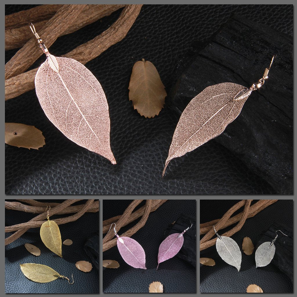 Skeletal leaf earrings, available in rose, gold, silver, and pink.
