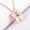 Divine Daisy - A delicate white enamel jewellery set dotted with Swarovski crystals.