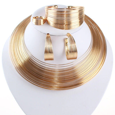 Aminatu Multi-Strand Torque Set I - A beautiful jewellery set made of narrow strands of gold-plated wire. Contains torque-style necklace, bracelet, earrings, and ring.