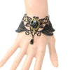 The Rosalie Cuff - A delicate black lace gothic cuff adorned with black roses and bronze hardware.