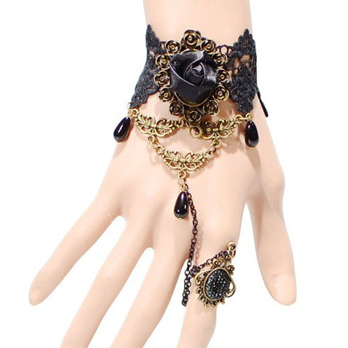 The Elizabeth Cuff - A black lace Victoria-style cuff adorned with black roses, gems, and bronze hardware.