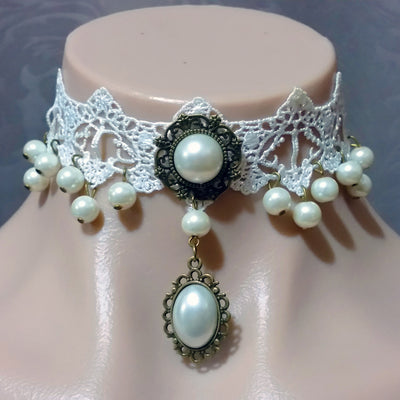 The Annabelle Choker - A white lace choker adorned with faux pearls and bronze hardware.