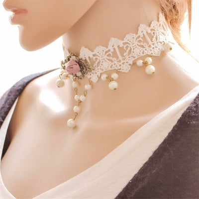 The Samantha Choker - A delicate white lace choker adorned with pink roses, faux pearls, and bronze hardware.