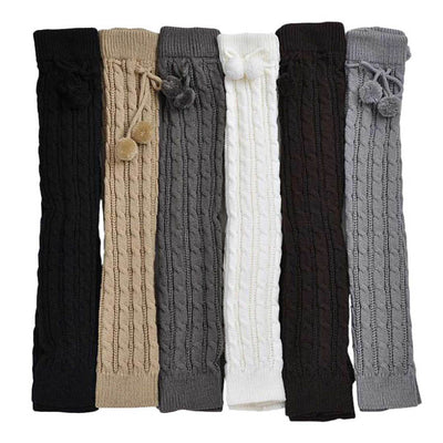 The Snuggle Weather Leg Warmers - A pair of adorable knit over-knee leg warmers available in six snuggly winter colours: Blackout (black),  Hot Chocolate (dark brown), Tempest (dark grey), Overcast (light grey), Gingerbread (light brown), and Snowdrift (white).