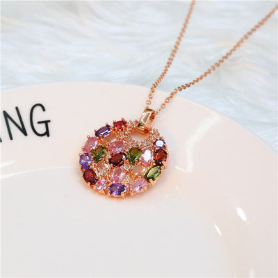 Bijoux Multi-Stone Disc Necklace - A lovely rose gold pendant studded with a rainbow of crystals.