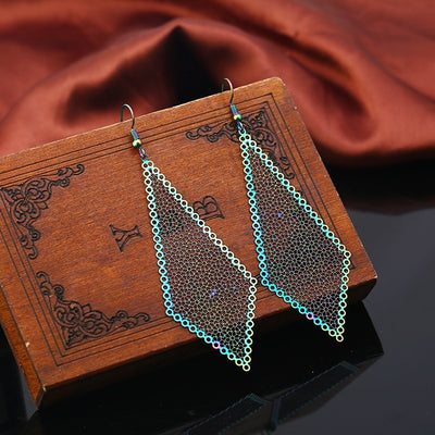 The Dazzle Collection - Quaderrific - UV treated stainless steel earrings that glow in a rainbow of colours.