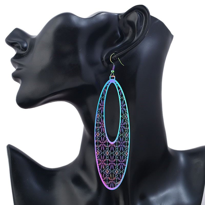 The Dazzle Collection - Chantel - UV treated stainless steel earrings that glow in a rainbow of colours.