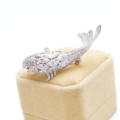 Luxe Koi Brooch - A lovely fish-shaped brooch with scales made of crystal, available with gold or silver coloured metal.