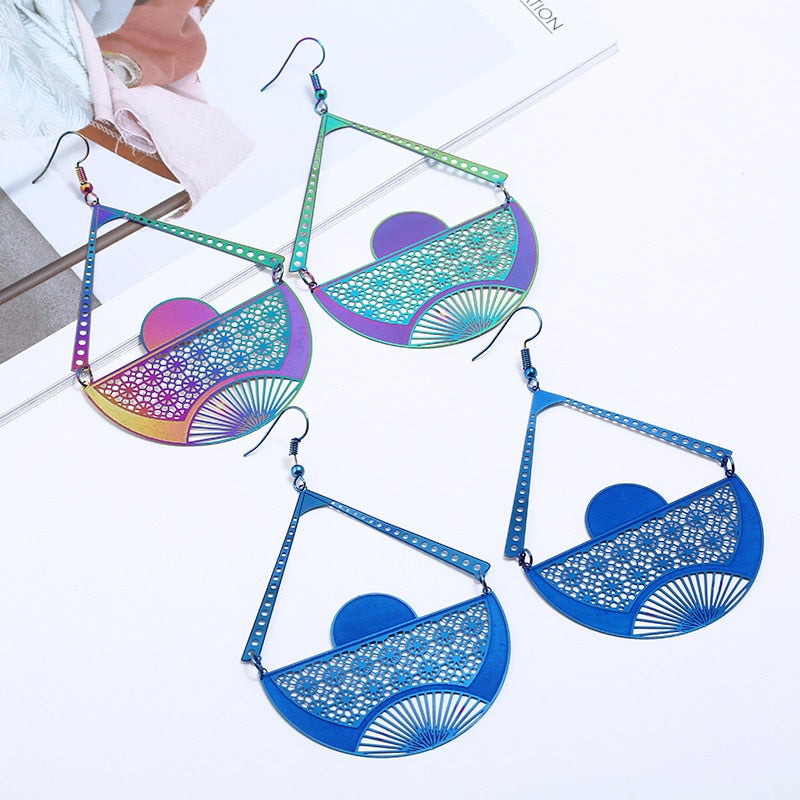 The Dazzle Collection - Aurora - UV treated stainless steel earrings that glow in a rainbow of colours.