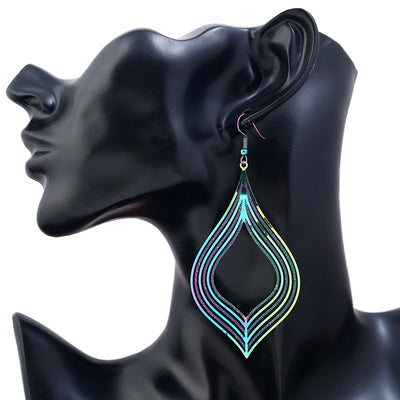 The Dazzle Collection - Vashanti - UV treated stainless steel earrings that glow in a rainbow of colours.