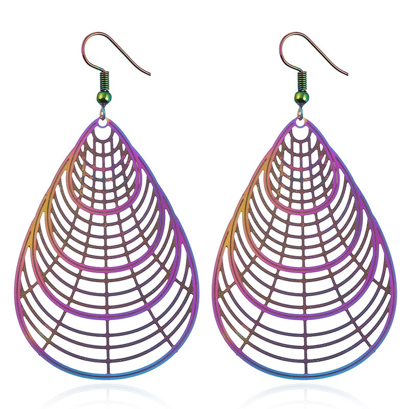 The Dazzle Collection - Arachne - UV treated stainless steel earrings that glow in a rainbow of colours.