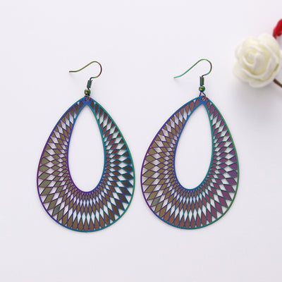 The Dazzle Collection - Illusionary - UV treated stainless steel earrings that glow in a rainbow of colours.
