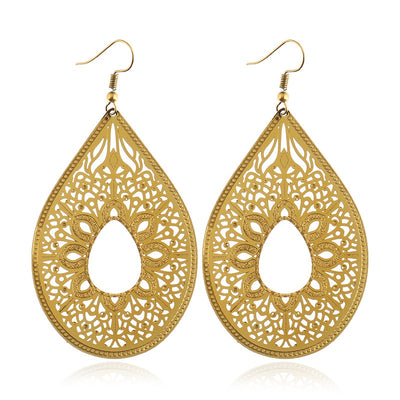 Set phasers to stunning by adding a pair of the lovely Priyanka Earrings to your wardrobe today! These earrings feature an elegantly curved teardrop shape, filled with an intricate web of curves and lace-like latticing. You'll be the talk of the office in all the best ways with a pair of these on your ears!