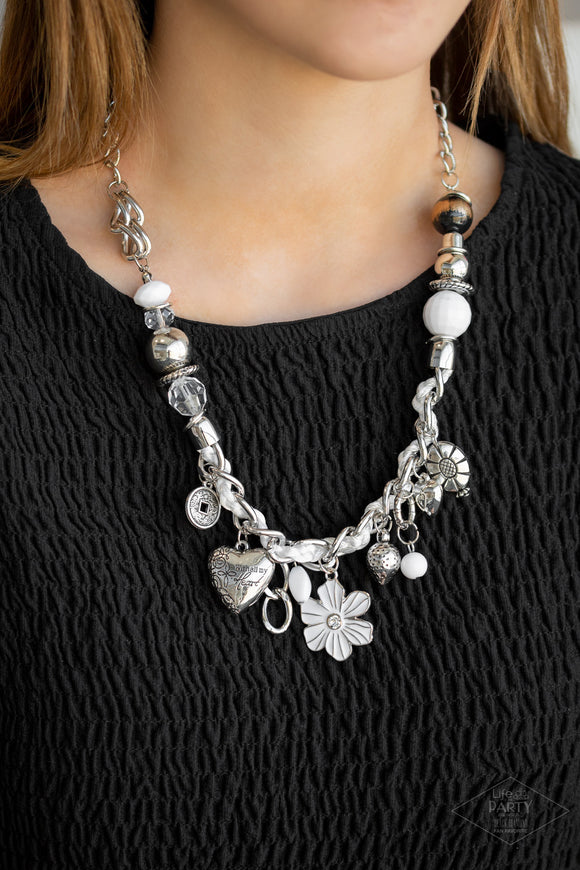 Charmed, I Am Sure White Necklace & Earrings - Paparazzi Accessories - White and ivory cording is braided through a chunky silver chain. A unique variety of charms decorate the piece including a delicate flower and a heart inscribed with the phrase