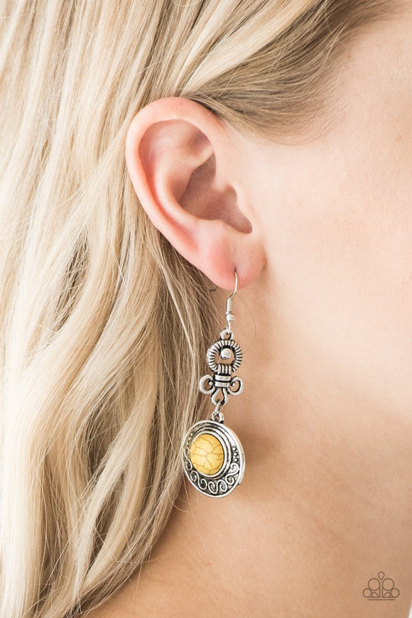 Southern Serenity Yellow & Silver Earrings - Paparazzi Accessories  Dotted with a sunny yellow stone center, an embellished silver frame swings from the bottom of an abstract silver fitting for a seasonal look. Earring attaches to a standard fishhook fitting. Sold as a pair of earrings.