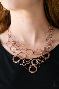 Main Street Mechanics - Copper Necklace & Earrings - Paparazzi Accessories  Featuring beveled and smooth surfaces, mismatched copper rings link below the collar in three glistening layers for a gritty look. Features an adjustable clasp closure. Sold as one individual necklace. Includes one pair of matching earrings. Paparazzi Accessories are Lead and Nickel Free.