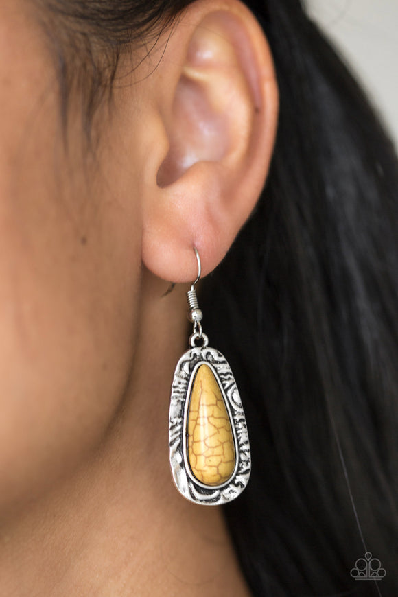Cruzin Colorado Yellow Earrings - Paparazzi Accessories -  Chiseled into a tranquil teardrop, a sunny yellow stone is pressed into the center of a shimmery silver frame radiating with hammered details for an artisan inspired look. Earring attaches to a standard fishhook fitting.  Sold as one pair of earrings.  Paparazzi Accessories are Lead and Nickel Free.
