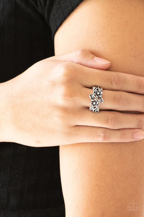 Stop and Smell The Flowers - Silver Ring - Paparazzi Accessories Brushed in an antiqued shimmer, leafy flowers bloom across the finger for a seasonal look. Features a dainty stretchy band for a flexible fit. Sold as one individual ring.