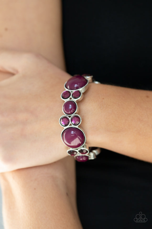 Celestial Escape - Purple & Silver Stretchy Bracelet - Paparazzi Accessories  Infused with pairs of Magenta Purple rhinestones, mismatched Magenta Purple beaded silver frames are delicately threaded along stretchy bands around the wrist for a whimsical pop of color. Sold as one individual bracelet.