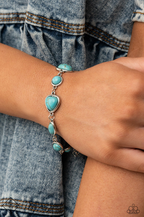 ​Eco-Friendly Fashionista - Blue Turquoise and Silver Bracelet - Paparazzi Accessories  Encased in sleek silver frames, a collection of round, oval, and triangular turquoise stones delicately link around the wrist for a one-of-a-kind look with an artisan feel. Features an adjustable clasp closure. Sold as one individual bracelet.