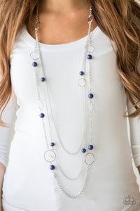 Beachside Babe - Blue Necklace & Earrings - Paparazzi Accessories   Featuring refreshing blue beads and shimmery silver hoops, mismatched silver chains layer down the chest for a seasonal look. Features an adjustable clasp closure. Sold as one individual necklace. Includes one pair of matching earrings.