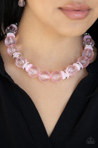 Bubbly Beauty - Pink Necklace & Earrings - Paparazzi Accessories   Featuring dainty silver and pink acrylic discs, a collection of oversized glassy pink beads are threaded along an invisible wire below the collar for a colorfully bubbly look. Features an adjustable clasp closure. Sold as one individual necklace. Includes one pair of matching earrings. Paparazzi Accessories are Lead and Nickel Free.