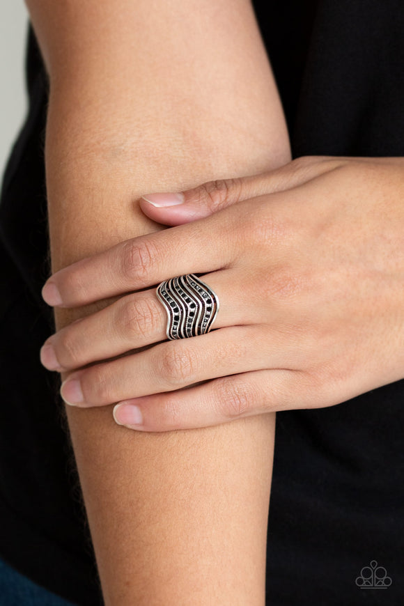 Fashion Finance - Black & Silver Ring - Paparazzi Accessories   Dotted in glittery black rhinestones, studded silver bars and smooth silver bars wave across the finger into edgy stacks. Features a stretchy band for a flexible fit. Sold as one individual ring.
