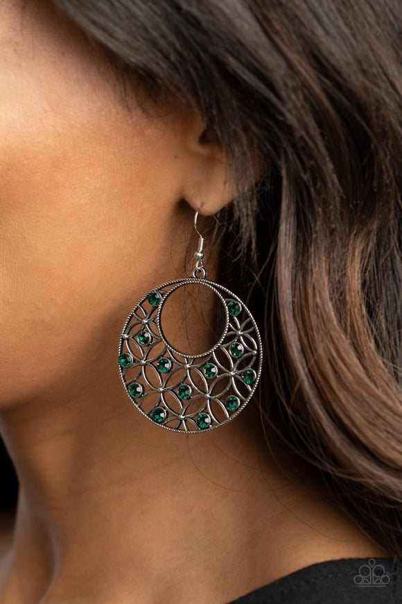 Garden Garnish - Green & Silver Earrings - Paparazzi Accessories -  Dotted with glittery green rhinestones, an airy backdrop of antiqued flowers climb a studded silver hoop for a whimsical look. Earring attaches to a standard fishhook fitting. Sold as one pair of earrings.