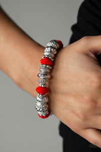 Live Life To The COLOR-fullest Red & Silver Bracelet - Paparazzi Accessories - A collection of faceted red beads, ornate silver beads, and studded silver rings are threaded along a stretchy band around the wrist for a colorfully refined look. Sold as one individual bracelet. Paparazzi Accessories are Lead and Nickel Free.