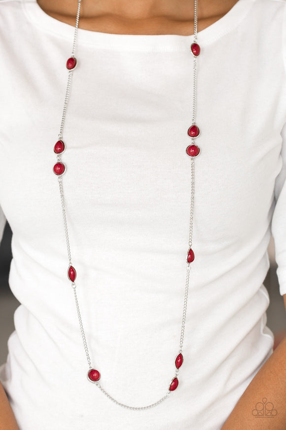 Pacific Piers - Red & Silver Necklace - Paparazzi Accessories  Featuring round and teardrop shapes, rich red beading trickles along an elongated silver chain for a seasonal look. Features an adjustable clasp closure. Sold as one individual necklace. Includes one pair of matching earrings.