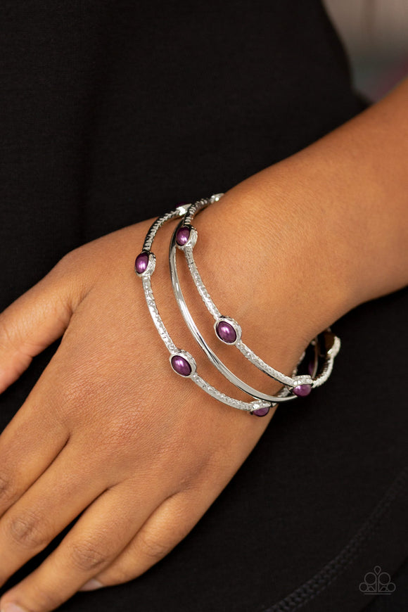 Bangle Belle - Purple Bangle Bracelets - Paparazzi Accessories  Delicately hammered in shimmer, a pair of pearly purple encrusted bangles joins a smooth silver bangle around the wrist for a refined fashion. Sold as one set of three bracelets.