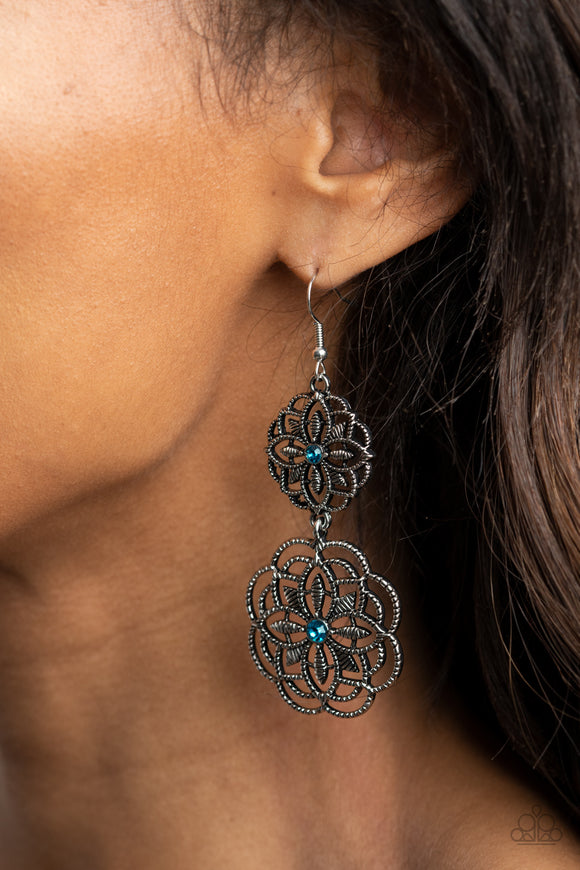 Mandala Mecca - Blue and Silver Earrings - Paparazzi Accessories -  Dotted with dainty blue rhinestone centers, studded mandala-like silver frames connect into a whimsical floral lure. Earring attaches to a standard fishhook fitting. Sold as one pair of earrings.