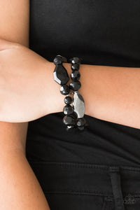 Rockin Rock Candy - Black Stretchy Bracelets - Paparazzi Accessories   Mismatched gunmetal, polished black, and crystal-like beads are threaded along interlocking stretchy bands for a whimsical look.