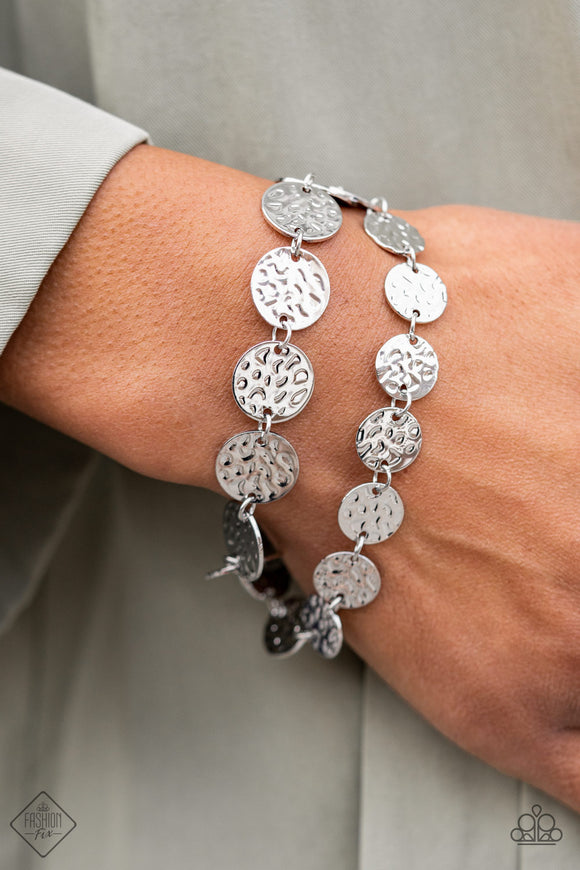 Rooted To The SPOTLIGHT - Silver Bracelet - Adjustable Clasp - Paparazzi Accessories  Two rows of hammered silver discs wrap around the wrist, creating an edgy shimmer. Features an adjustable clasp closure. Sold as one individual bracelet.