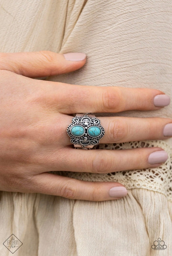 Eco Essence - Blue Turquoise and Silver Ring - Paparazzi Accessories  Two refreshing turquoise stones dot a thick silver band radiating with swirling studded detail, creating an earthy centerpiece atop the finger. Features a stretchy band for a flexible fit. Sold as one individual ring.