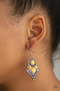 So Sonoran - Yellow Earrings - Paparazzi Accessories   Chiseled into round and square beads, sunny yellow stones are pressed into an ornate geometric frame radiating with shimmery silver studs for a tribal inspired look. Earring attaches to a standard fishhook fitting. Sold as one pair of earrings. Paparazzi Accessories are Lead & Nickel Free.