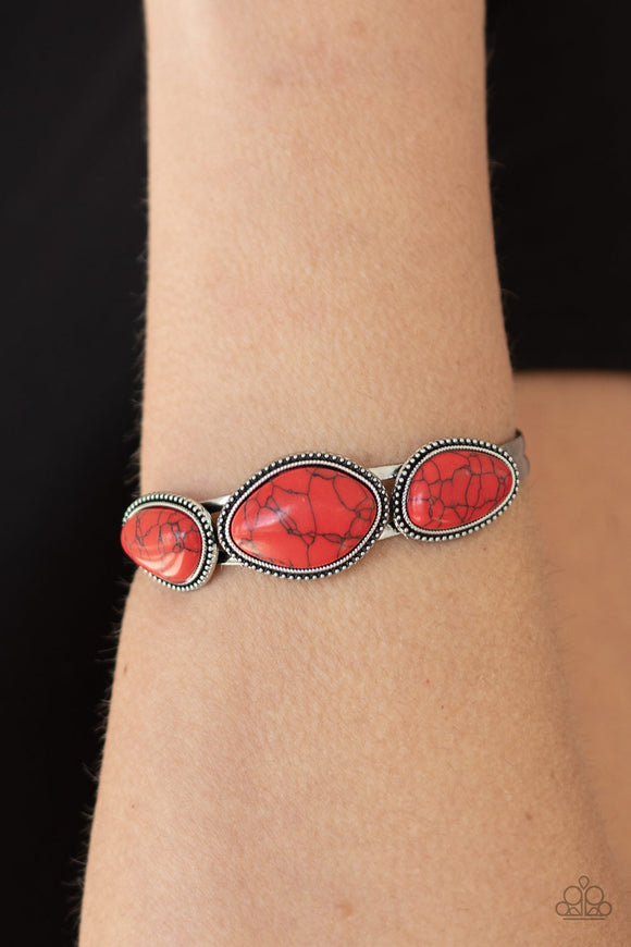 Stone Solace - Red & Silver Cuff Bracelet - Paparazzi Accessories  Featuring antiqued studded frames, three asymmetrical red stones are pressed into the top of a dainty silver cuff for an artisan inspired look. Sold as one individual bracelet. Paparazzi Accessories are Lead Free and Nickel Free.