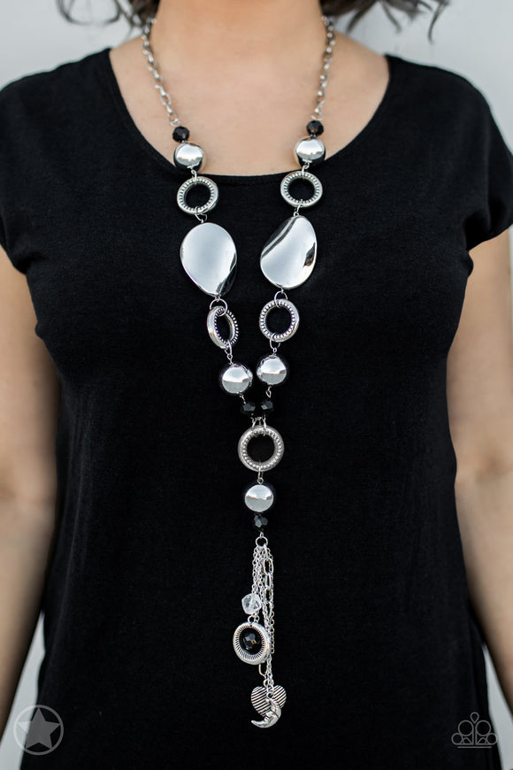Total Eclipse Of the Heart Silver Necklace & Earrings - Paparazzi Accessories   Long chain of black crystalized beads, curved plates of silver with a pearly finish, and chunky silver rings lead down to a tassel of chains and charms, including a crescent moon and a heart. Sold as one individual necklace. Includes one pair of matching earrings. Paparazzi Accessories are Lead & Nickel Free.
