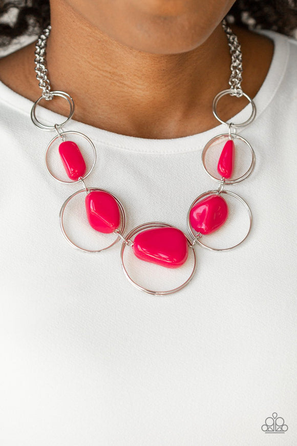 Travel Log Pink Stone Silver Necklace - Paparazzi Accessories - Featuring faux pink rock beads, exaggerated silver hoops gradually increase in size as they link below the collar for a trendy look. Features an adjustable clasp closure. Sold as one individual necklace. Includes one pair of matching earrings. Paparazzi Accessories are Lead and Nickel Free.