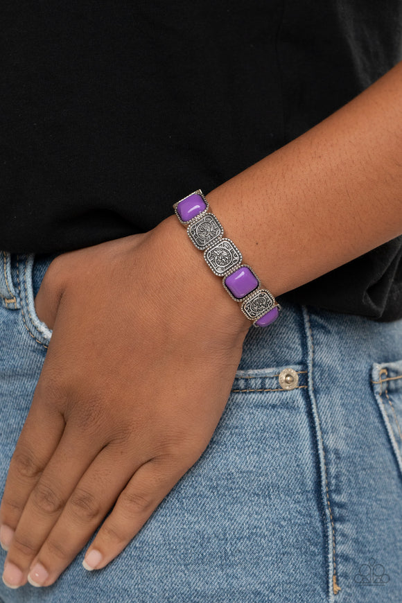 Trendy Tease - Purple and Silver Stretchy Bracelet - Paparazzi Accessories  Studded in abstract textures, antiqued silver frames join square purple beaded frames along a stretchy band around the wrist for a colorfully vintage look. Sold as one individual bracelet.