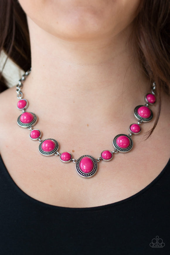 Voyager Vibes - Pink Necklace & Earrings - Paparazzi Accessories   Featuring smooth and studded silver frames, vivacious pink beads link below the collar in a seasonal fashion. Features an adjustable clasp closure. Sold as one individual necklace. Includes one pair of matching earrings.