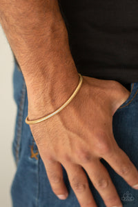 Winning - Gold Snake Chain - Men's Bracelet - Paparazzi Accessories  Brushed in a high-sheen shimmer, a rounded gold snake chain links around the wrist for a sleek look. Features an adjustable clasp closure.