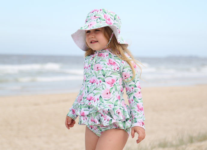 Girls swimsuit and hat in Pink Bloom