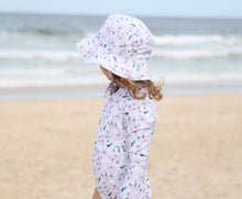 Load image into Gallery viewer, Sun hat and girls swimsuit in Floral Whisper at the beach