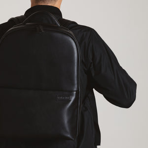 Black camera backpack by No More Ugly