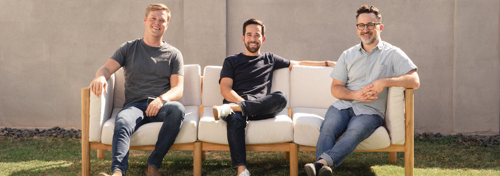 Neighbor's co-founders, Chris Lee, Nick Arambula, and Mike Fretto sitting on an outdoor sofa.