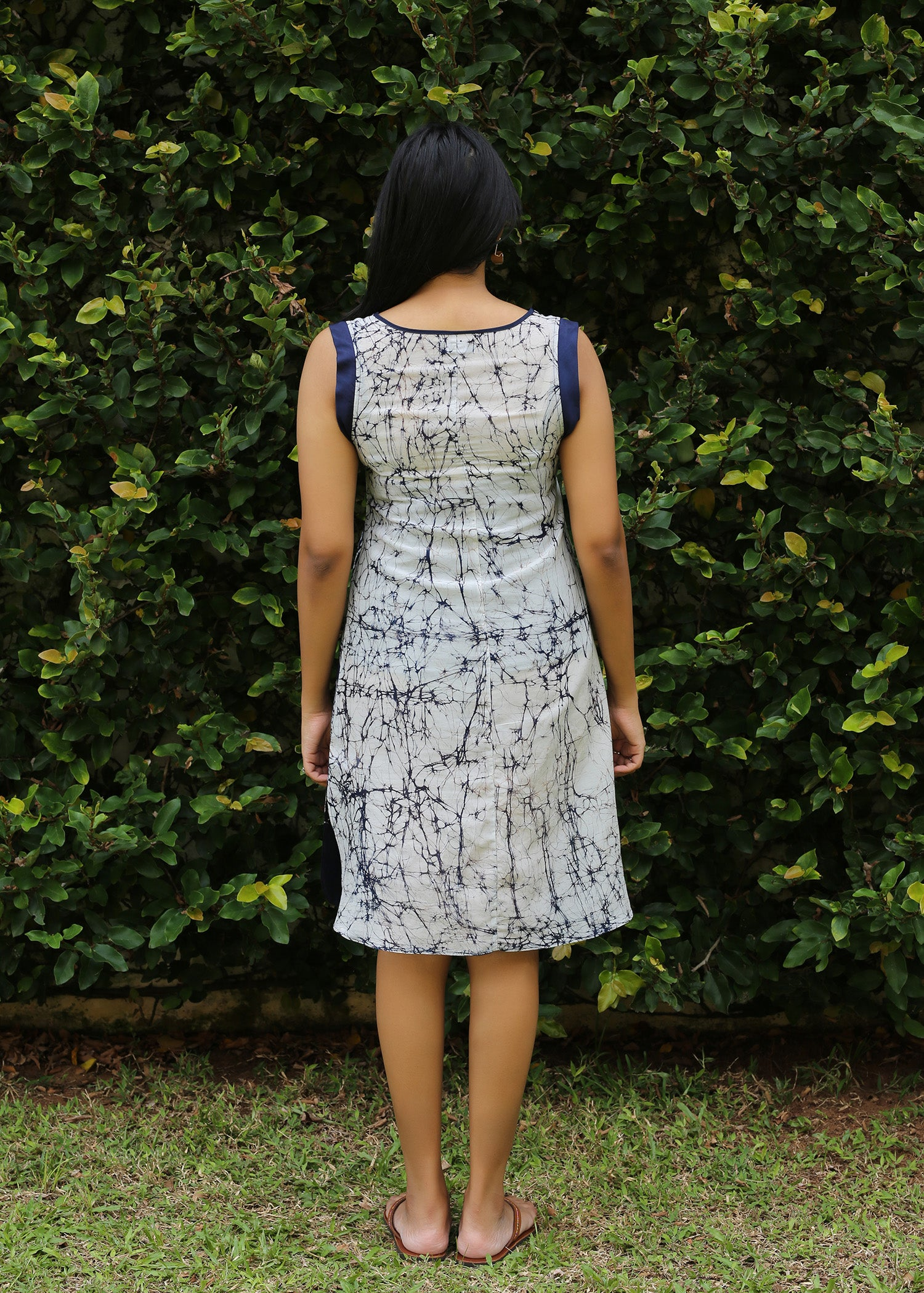 Sleeveless batik dress with mini side slit